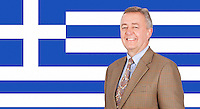 Portrait of middle-aged businessman smiling over Greek flag