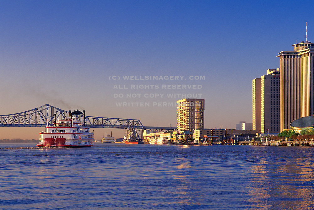 Image of the Flamingo Casino Paddlewheeler Riverboat on the Mississippi River with the skyline of New Orleans, Louisiana, American South