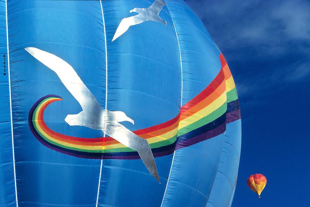 Hot-air balloons soar above Monument Valley, Utah.