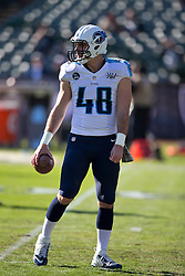 OAKLAND, CA - NOVEMBER 24: Beau Brinkley #48 of the Tennessee Titans warms up before the game against the Oakland Raiders at O.co Coliseum on November 24, 2013 in Oakland, California. The Tennessee Titans defeated the Oakland Raiders 23-19. (Photo by Jason O. Watson/Getty Images) *** Local Caption *** Beau Brinkley