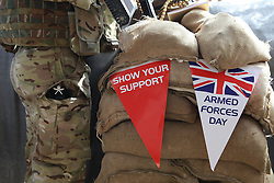 © London News Pictures. 24/06/11.Armed forces day banners in Afghanistan. A member of 2 Royal Gurkha Rifles (RGR) on sangar duties at the Regional Training Centre (RTC) in Lashkar Gah. Mandatory credit Alison Baskerville/LNP
