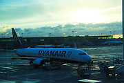 Ryanair plane at Stansted airport, Essex, England, UK seen through glass window