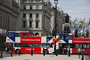 Tour buses with The Original Tour drive along Pall Mall, passing Lower Regent Street, on 7th July 2017, in central London.