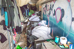 © Licensed to London News Pictures . 30/04/2017 . Salford, UK . Two men lie sleeping on sofas on the towpath . Homeless men are living in a towpath tunnel in Saford , in the shadow of the Ordsall Chord railway link and a large , Chinese-backed housing development. Photo credit : Joel Goodman/LNP