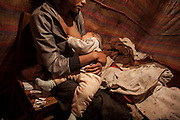 A 17 years old prostitute in her hovel in Abnet. In side areas girls pay about 100 birr (4 €) to rent a small place, to be used for sex work. <br /> <br /> Addis Ababa, Ethiopia, 20-12-2012.<br /> <br /> To protect the identities of the recorded subjects names are omitted