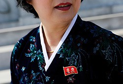 A North Korean tour guide is seen wearing a pin of former leaders Kim Il-sung and Kim Jong-il at the Tower of the Juche Ider in Pyongyang, North Korea, 12 April 2017. North Koreans prepare to celebrate the 'Day of the Sun Festival', 105th birthday anniversary of former North Korean supreme leader Kim Il-sung in Pyongyang on 15 April.