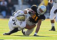 November 10 2012: Purdue Boilermakers linebacker Joe Gilliam (39) pulls down Iowa Hawkeyes wide receiver Tevaun Smith (81) after a catch during the NCAA football game between the Purdue Boilermakers and the Iowa Hawkeyes at Kinnick Stadium in Iowa City, Iowa on Saturday, November 10, 2012. Purdue defeated Iowa 27-24.
