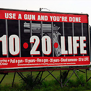 "Billboard ""Use a Gun and You're Done"" 10-20-Life, During a Crime  Pull a gun - 10 years, Fire a gun 20 years, Shoot someone - 25 to Life"