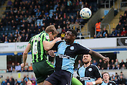both Paul Robinson defender for AFC Wimbledon (6) and Wycombe Wanderers defender Anthony Stewart (5) jump for the ball during the Sky Bet League 2 match between Wycombe Wanderers and AFC Wimbledon at Adams Park, High Wycombe, England on 2 April 2016. Photo by Stuart Butcher.