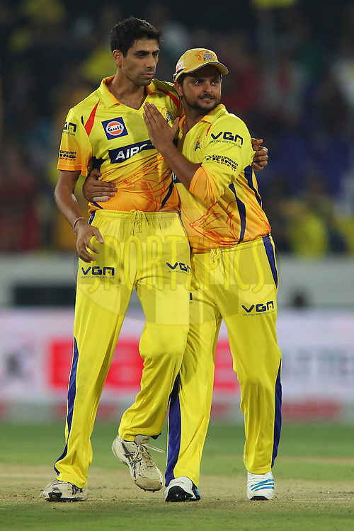 Ashish NEHRA of the Chennai Superkings  and Suresh RAINA of the Chennai Superkings celebrate the wicket of Wriddhiman SAHA of the Kings XI Punjab  during the second semi final match of the Oppo Champions League Twenty20 between the Kings XI Punjab and the Chennai Superkings held at the Rajiv Gandhi Cricket Stadium, Hyderabad, India on the 2nd October 2014<br /> <br /> Photo by:  Ron Gaunt / Sportzpics/ CLT20<br /> <br /> <br /> Image use is subject to the terms and conditions as laid out by the BCCI/ CLT20.  The terms and conditions can be downloaded here:<br /> <br /> http://sportzpics.photoshelter.com/gallery/CLT20-Image-Terms-and-Conditions-2014/G0000IfNJn535VPU/C0000QhhKadWcjYs