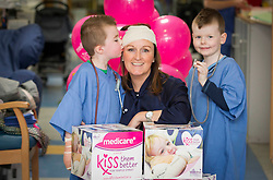 Jenny brings magic kisses to Temple Street .Rhys Law (age 4) and Frank Dunphy, (age 4)  are pictured with Jenny Kelly, Today FM presenter with her partner Ray D'arcy and busy mum of two as she visited Temple Street Children's Hospital to launch Kiss Them Better - the hospital's newest appeal to raise vital funds for emergency equipment.  She is asking mums everywhere to pick up a pack of Medicare Kiss Them Better plasters from their local pharmacies.  For every special pack bought, Medicare will make a donation to help sick children get better.  Picture Andres Poveda
