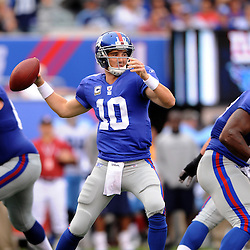 New York Giants quarterback Eli Manning (10) passes during first half NFL football action between the New York Giants and Tennessee Titans at New Meadowlands Stadium in East Rutherford, New Jersey. The game is tied at half time.