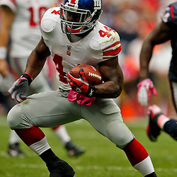 October 10, 2010; Houston, TX USA; New York Giants running back Ahmad Bradshaw (44) runs with the ball during the first half against the Houston Texans at Reliant Stadium. Mandatory Credit: Derick E. Hingle