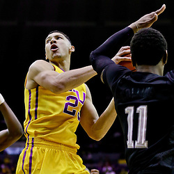 Feb 13, 2016; Baton Rouge, LA, USA; LSU Tigers forward Ben Simmons (25) drives to the basket past Texas A&M Aggies guard Danuel House (23) and Texas A&M Aggies guard Anthony Collins (11) during the first half of a game at the Pete Maravich Assembly Center. Mandatory Credit: Derick E. Hingle-USA TODAY Sports