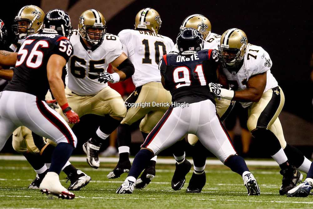 August 21, 2010; New Orleans, LA, USA; New Orleans Saints offensive tackle Charles Brown (71) blocks against Houston Texans defensive tackle Amobi Okoye (91) during the second quarter of a preseason game at the Louisiana Superdome. Mandatory Credit: Derick E. Hingle