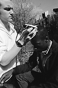 Neville shaving Barry's head at Hawthorne Road, High Wycombe, UK, 1980s