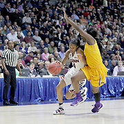 Moriah Jefferson, (left), UConn, drives past Khadidja Toure, East Carolina, during the UConn Huskies Vs East Carolina Pirates Quarter Final match at the  2016 American Athletic Conference Championships. Mohegan Sun Arena, Uncasville, Connecticut, USA. 5th March 2016. Photo Tim Clayton