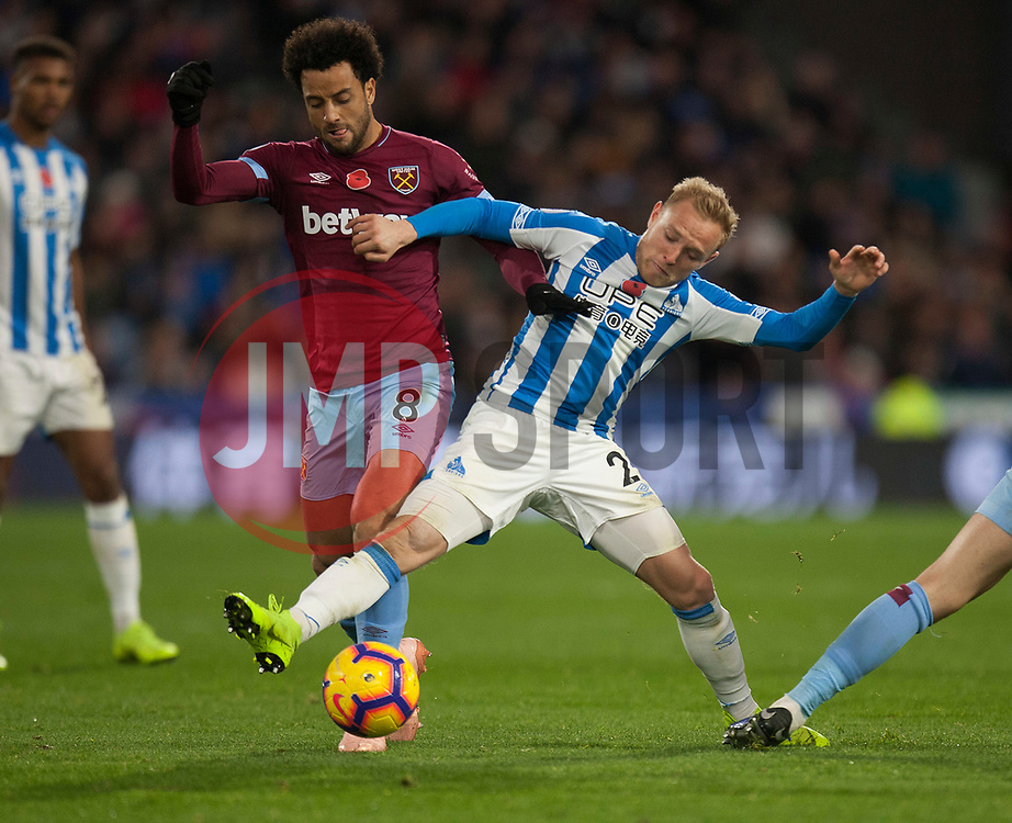 Felipe Anderson of West Ham United (L) and Alex Pritchard of Huddersfield Town in action - Mandatory by-line: Jack Phillips/JMP - 10/11/2018 - FOOTBALL - The John Smith's Stadium - Huddersfield, England - Huddersfield Town v West Ham United - English Premier League