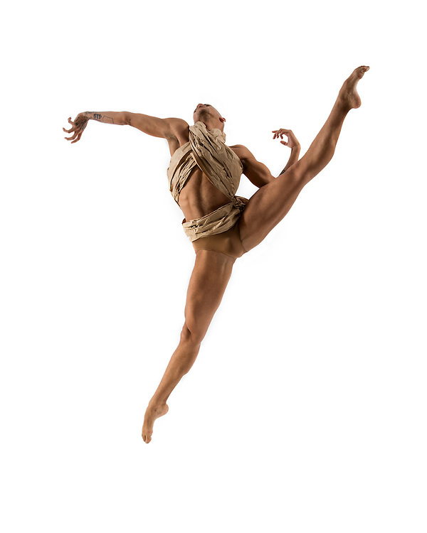 Contemporary male dancer, Terk Lewis, jumping in costume, taken in the photo studio on a white background. Photograph taken in New York City by photographer Rachel Neville.
