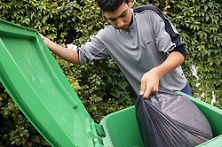Youth taking out the rubbish,