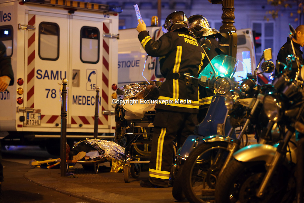 November 14, 2015 - Paris, France - <br /> Victims of the shooting at the Bataclan concert venue in central Paris are being evacuated to receive first aid. More than one hundred people were killed and many more wounded when gunmen opened fire inside the venue as the French capital has been the target of a series of deadly attacks.<br /> ©Exclusivepix Media