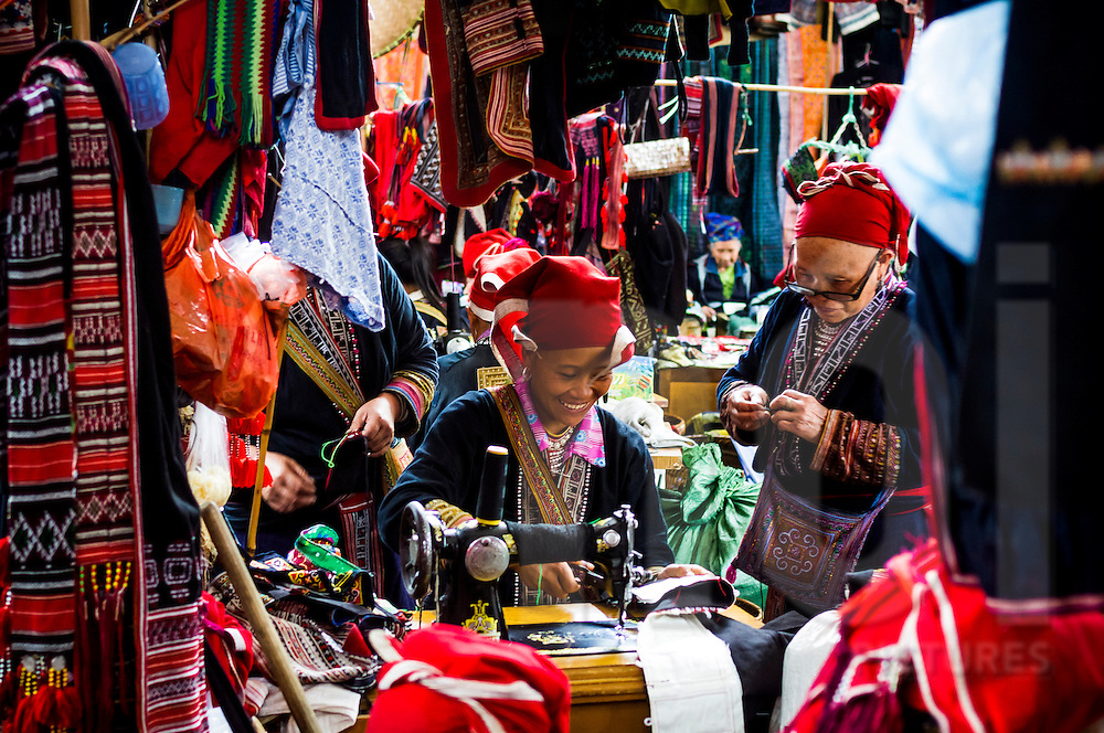 A Red Dao women at work in the market in Sapa, Vietnam, Asia
