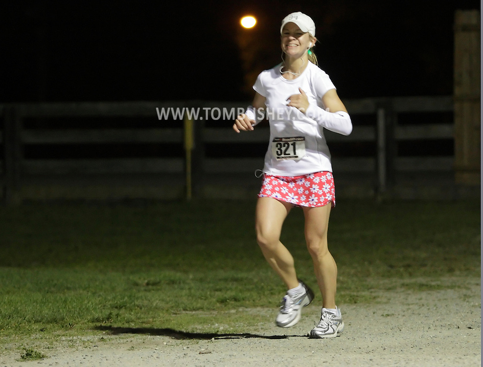 Augusta, New Jersey - Emily Grossman runs laps around the Sussex County Fairgrounds during the 3 Days at the Fair races on Saturday, May 15, 2010. She competed in the 24-hour race.