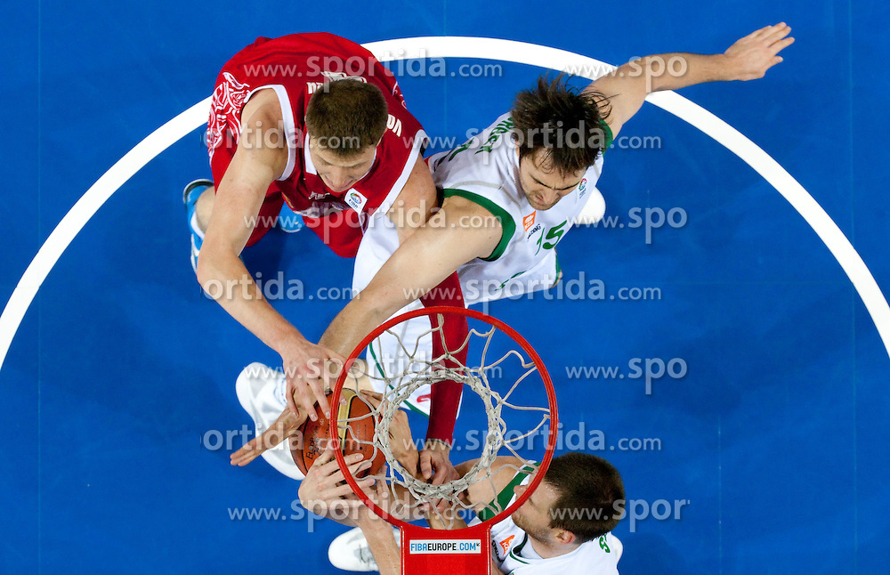 Andrey Vorontsevich of Russia vs Erazem Lorbek of Slovenia and Uros Slokar of Sloveniaduring basketball match between National teams of Slovenia and Slovenia in Group D of Preliminary Round of Eurobasket Lithuania 2011, on September 5, 2011, in Arena Svyturio, Klaipeda, Lithuania.  (Photo by Vid Ponikvar / Sportida)