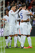 England striker Theo Walcott celebrates goal during the Group E UEFA European 2016 Qualifier match between England and Estonia at Wembley Stadium, London, England on 9 October 2015. Photo by Alan Franklin.