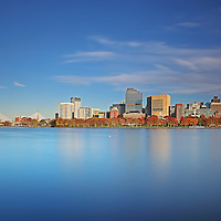 Boston skyline photography showing familiar Boston landmarks in a new light. From left to right one can see the Museum of Science, the Zakim Bridge or Bunker Hill Bridge, parts of Beacon Hill, the Massachusetts State House and the newly constructed Millennium Tower in Downtown Crossing. Boston skyline picture are available as museum quality photography prints, canvas prints, acrylic prints, wood prints or metal prints. Fine art prints may be framed and matted to the individual liking and decorating needs:<br />
