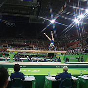 Gymnastics - Olympics: Day 2   Eythora Thorsdottir #367 of The Netherlands performing her routine on the Balance Beam during the Artistic Gymnastics Women's Team Qualification round at the Rio Olympic Arena on August 7, 2016 in Rio de Janeiro, Brazil. (Photo by Tim Clayton/Corbis via Getty Images)<br /> <br /> (Note to editors: A special effects starburst filter was used in the creation of this image)