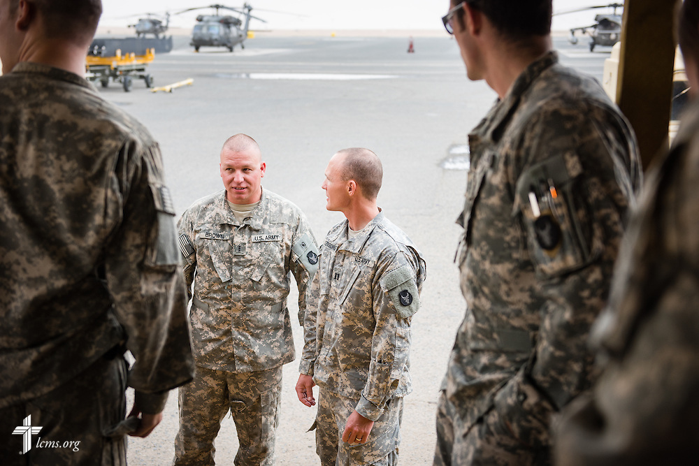 Army Capt. Chad Czischke (center), chaplain, visits with fellow soldiers on Sunday, March 22, 2015, at Camp Buehring in Kuwait. LCMS Communications/Erik M. Lunsford
