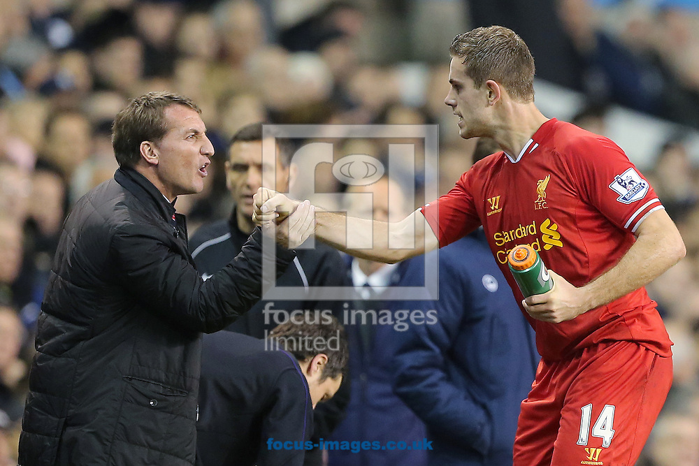 Picture by Richard Calver/Focus Images Ltd +447792 981244<br /> 15/12/2013<br /> Jordan Henderson of Liverpool is congratulated by Manager, Brendan Rodgers after making it 2-0 during the Barclays Premier League match against Tottenham Hotspur at White Hart Lane, London.