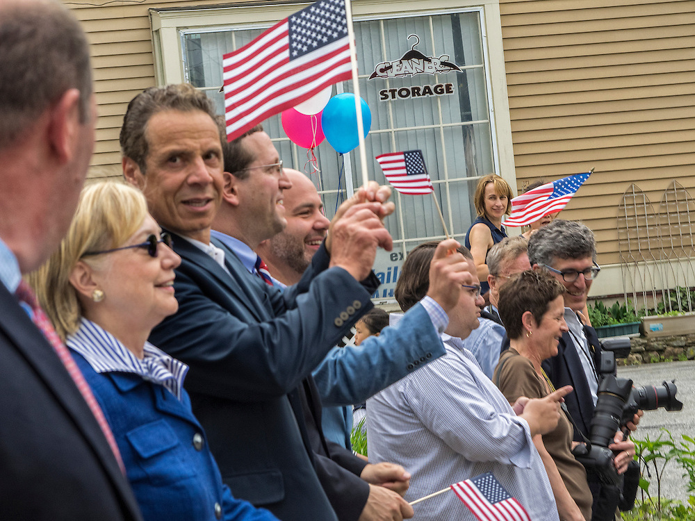 Chappaqua, NY, USA, May 30: Democratic Presidential Candidate Hillary Clinton and NY Governor Andrew Cuomo march in the Memorial Day Parade on May 30, 2016 in the Clinton's home town of Chappaqua NY.