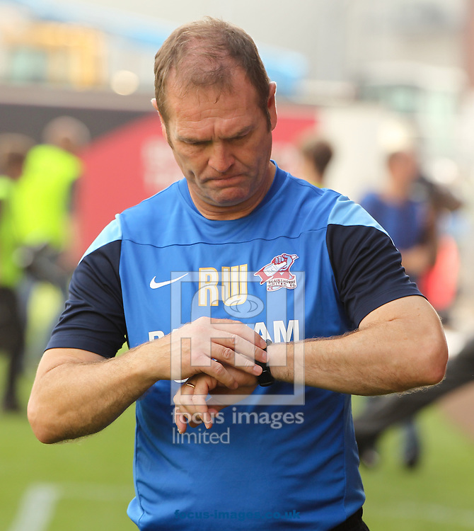 Scunthorpe manager Russ Wilcox checks his watch before the Sky Bet League 1 match at Ashton Gate, Bristol<br /> Picture by Tom Smith/Focus Images Ltd 07545141164<br /> 06/09/2014