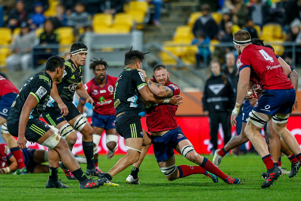 Scott Higginbotham (captain) tackled during the Super rugby union game (Round 14) played between Hurricanes v Reds, on 18 May 2018, at Westpac Stadium, Wellington, New  Zealand.    Hurricanes won 38-34.