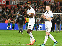 Football - 2017 / 2018 Premier League - Swansea City vs. Southampton<br /> <br /> Tammy Abraham of Swansea City & Alfie Mawson of Swansea City leave the piitch after the end of the game , at Liberty Stadium.<br /> <br /> COLORSPORT/WINSTON BYNORTH