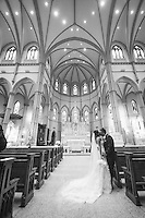 A gorgeous wedding couple sneak a kiss inside St. Paul's Cathedral located in the Oakland neighborhood of Pittsburgh, PA.