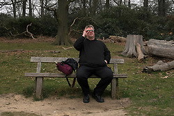 © Licensed to London News Pictures. 20/03/2015. Richmond, UK. Stephan (SIC) Mayer from Kingston tries out his eclipse protection glasses.  People watch the cloudy sky darken during the near total eclipse at Richmond Park, Surrey today 20th March 2015. Photo credit : Stephen Simpson/LNP