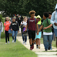 Adam Robison | BUY AT PHOTOS.DJOURNAL.COM<br /> Students from Tupelo Middle School use the sidewalk on Milford Street as they walk home after school Friday afternoon.