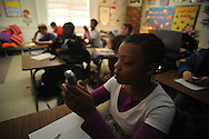 Lafayette Middle School student Kierra Gipson uses a clicker to answer questions projected from a learning tablet in Penny Allen's class on Thursday, January 14, 2010.