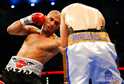 April 12, 2008; Atlantic City, NJ, USA;  Miguel Cotto (Black w/Gray) rips a left hook to the body of  Alfonso Gomez (White, Blue & Gold) during their 12 round WBA Welterweight Championship fight at Boardwalk Hall in Atlantic City, NJ.