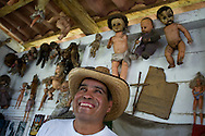 Anastasio Santana at The Island of the Dolls (Isla de las Muñecas). Dead dolls of all kinds hang from the trees and vines and rafters, their eyes bewitching and disturbing the visitors who have come to gawk and photograph in this surreal sanctuary in Xochimilco, Mexico. Feb. 24, 2008. (ivan gonzalez).