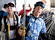 NEWS&amp;GUIDE PHOTO / PRICE CHAMBERS<br /> Toby Grohne and Lauren Penix react when they are cut off from the line of people getting on the last winter aerial tram at Jackson Hole Mountain Resort Sunday afternoon. The two expressed their regret and surprise at the situation when the gate was closed and no more skiers were allowed on the tram. The occasion drew thousands of skiers, many which dressed up in costumes to celebrate the valley icon's retirement.