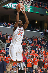 Virginia guard Jeff Jones (23) completes an alley-oop against Miami.The Virginia Cavaliers fell to the Miami Hurricanes 62-55 at the John Paul Jones Arena on the Grounds of the University of Virginia in Charlottesville, VA on February 26, 2009.
