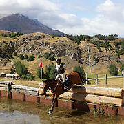 Toni Finch on Free Ride home in action at the water jump during the Cross Country event at the Wakatipu One Day Horse Trials at the Pony Club grounds,  Queenstown, Otago, New Zealand. 15th January 2012. Photo Tim Clayton