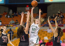 Wyoming East guard Gabby Lupardus (32) throws up a shot with many Bluefield defenders during a first round game at the Charleston Civic Center.