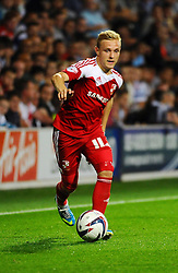 Swindon Town's Alex Pritchard  - Photo mandatory by-line: Seb Daly/JMP - Tel: Mobile: 07966 386802 27/08/2013 - SPORT - FOOTBALL - Loftus Road - London - Queens Park Rangers V Swindon Town -  Capital One Cup - Round 2