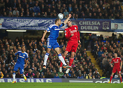 LONDON, ENGLAND - Tuesday, November 29, 2011: Chelsea's Alex handles the ball in the penalty area under pressure from Liverpool's Andy Carroll to give away a penalty during the Football League Cup Quarter-Final match at Stamford Bridge. (Pic by David Rawcliffe/Propaganda)