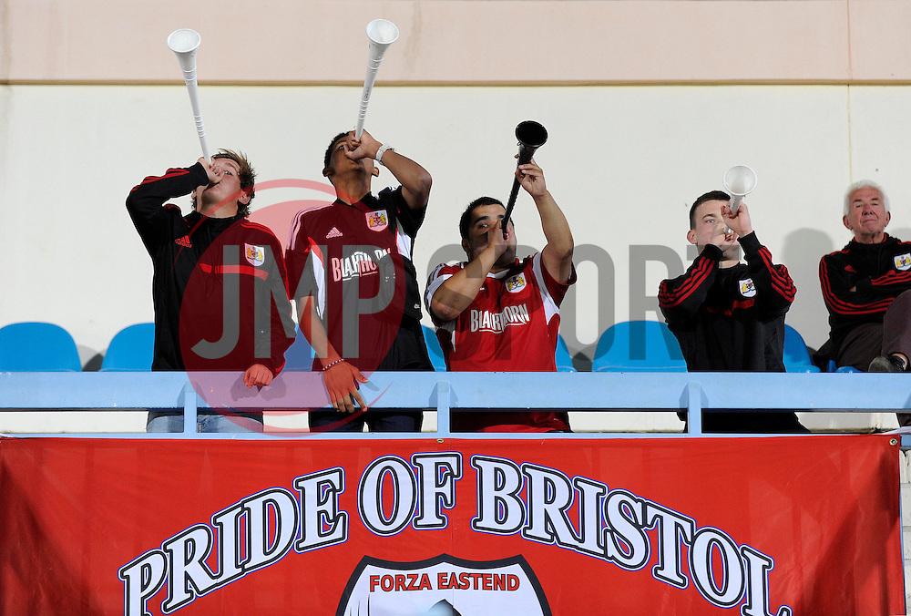 Harry Hornigold, Lloyd Kelly, Levi Hodge and George Windsor blow on vevellas  - Photo mandatory by-line: Dougie Allward/JMP - Mobile: 07966 386802 24/07/2014 - SPORT - FOOTBALL - Gaborone - Botswana Tour 2014  - Botswana v Bristol City